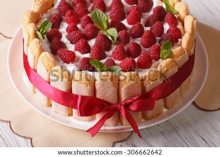 Beautiful raspberry tiramisu with mascarpone and Savoiardi close-up on the table. horizontal - stock photo