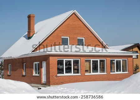 Beautiful red brick house in winter