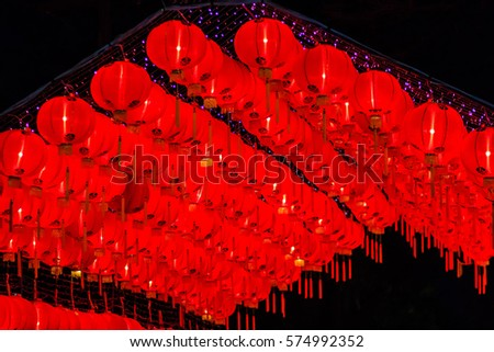 Beautiful red Chinese lantern on the night during new year festival with the Chinese character Blessings written on it.