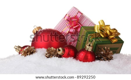 beautiful red Christmas balls, gifts and cones on snow isolated on white