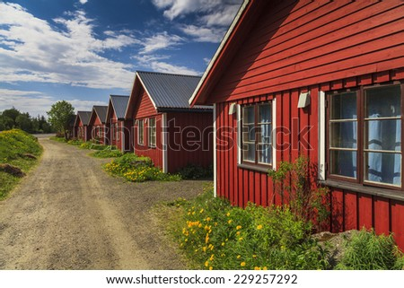Beautiful red cottage houses. Norway - stock photo