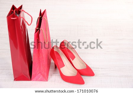 Beautiful red female shoes and shop bags