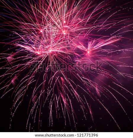 Beautiful red fireworks in the night sky - stock photo