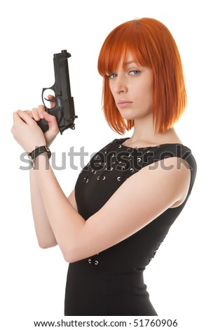 Beautiful red girl with a gun - stock photo