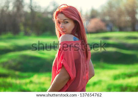 beautiful red-haired girl in a field