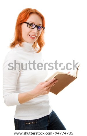 Beautiful red-haired girl in glasses reads book on a white background.