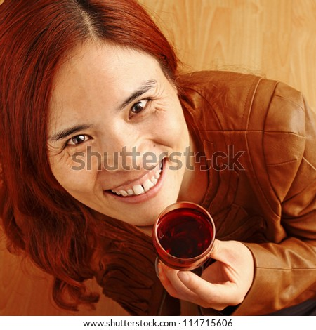 Beautiful Red Haired Girl with a Glass of Red Wine - stock photo