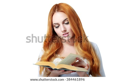 beautiful red haired woman reading book isolated over white - stock photo