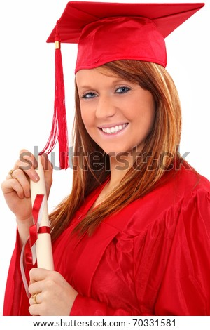 Beautiful red head young woman in red graduation cap and gown with diploma certificate over white.  Great smile. - stock photo