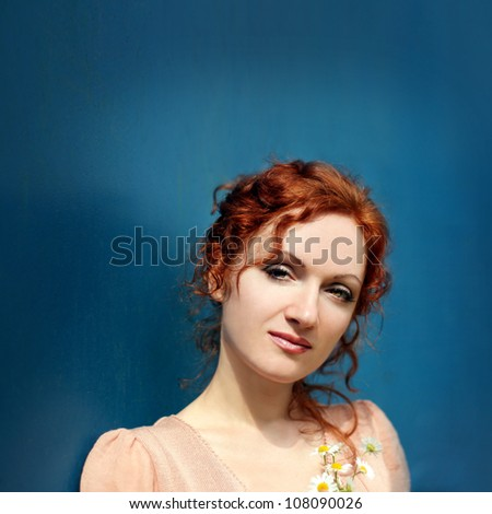 Beautiful red-heired woman - stock photo