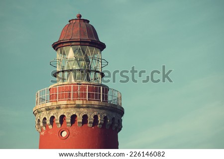 beautiful red Lighthouse Bovbjerg Fyr against blue skyin vintage style, Danish North Sea coast, Jutland, Denmark, Europe - stock photo