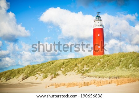 Beautiful red lighthouse of Texel island in the North Sea in Holland, Netherlands - stock photo