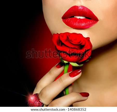 Beautiful Red Lips, Nails and Rose Flower. Beauty Girl. Makeup and Manicure. Sensual Mouth. Sexy Red Color Lips. Part of Face - stock photo