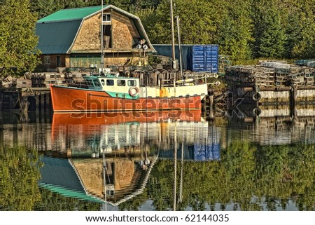 Beautiful Red Lobster Boat and Traps with Reflection - stock photo