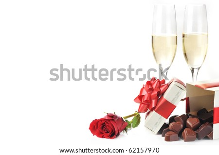 beautiful red rose, champagne  and chocolate  close up - stock photo