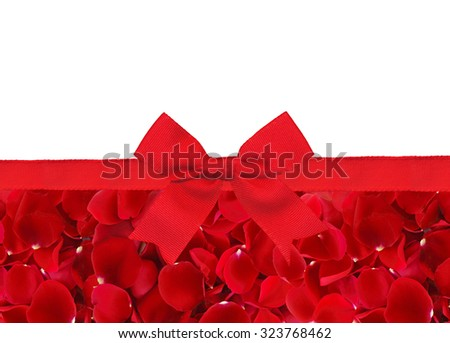 beautiful red rose petals and red ribbon with bow isolated on white background - stock photo