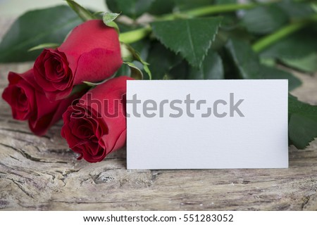beautiful red roses with old textured wood and empty space for lovely message