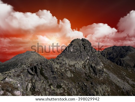 beautiful red sky over the mountains - stock photo