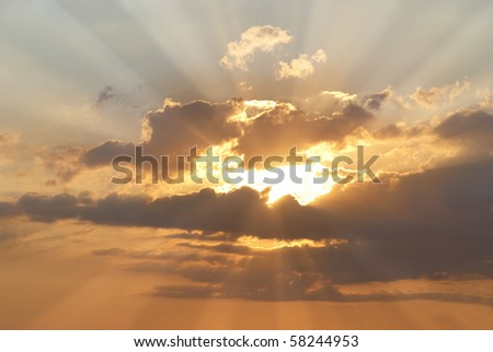 Beautiful red sky with sunbeams and clouds - stock photo