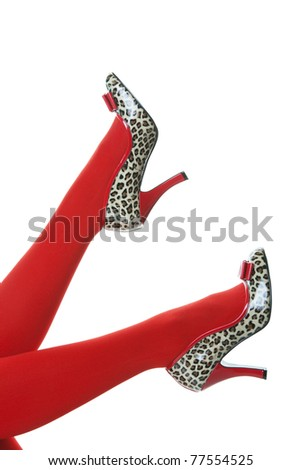 Beautiful red stockings, with shiny, red and animal print, rockabilly style high heels kicking up into the air.  Shot on white background.