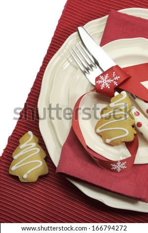 Beautiful red theme festive Christmas dining table place setting with Happy Holiday ornaments and decorations with copy space for your text here. - stock photo