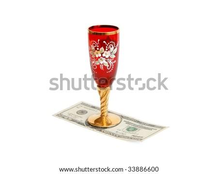 Beautiful red wine glass  with golden stem on twenty dollar bill isolated - stock photo