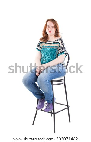 Beautiful redhead plus size model sitting on the bar chair. Isolated on a white background. - stock photo