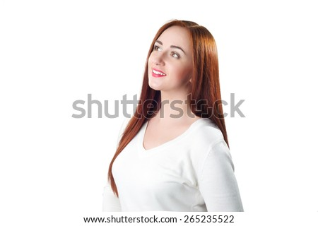 Beautiful redhead woman looking up isolated on white background