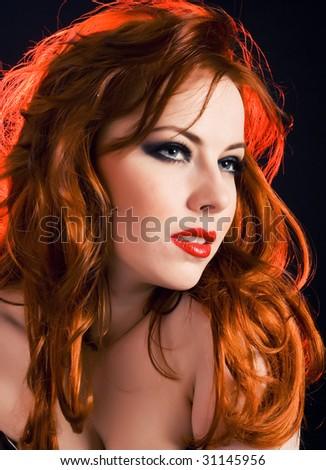 Beautiful redhead woman portrait close up - stock photo