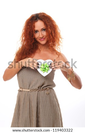 Beautiful redhead woman with gift in hands over a white background