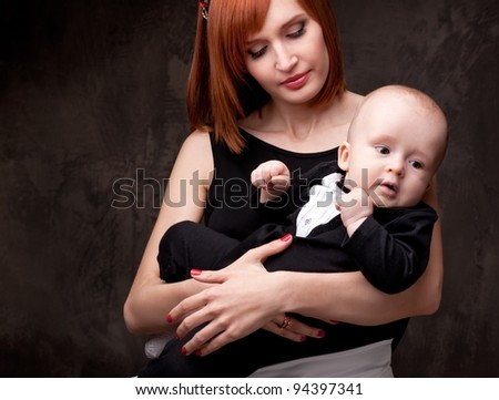Beautiful redhead woman with her child. - stock photo