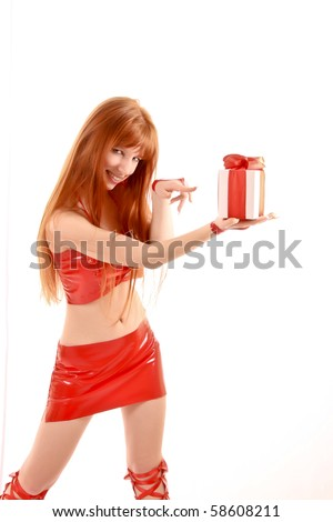 Beautiful redhead woman with present in hands isolated on white - stock photo