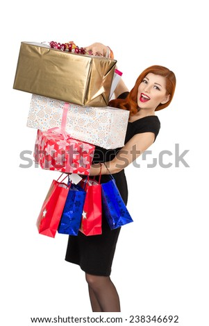 beautiful redhead young woman, stand with gift boxes,