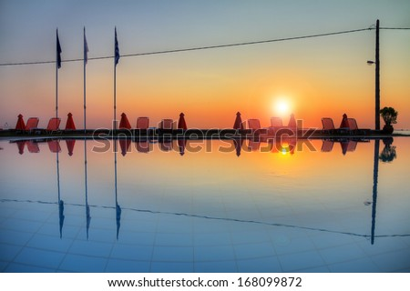 Beautiful reflection of the sunrise in a pool on the island of Zakynthos - stock photo