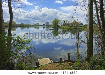 Beautiful reflections from the Lakes at Frampton on Severn in Spring, Gloucestershire, England, UK - stock photo
