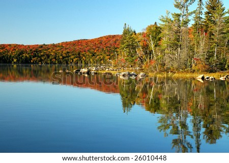 Beautiful reflections in the fall on Flack lake, Ontario