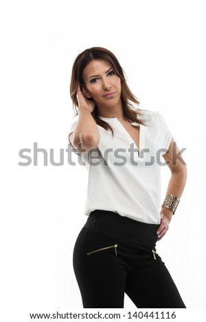 Beautiful relaxed photo model standing with her hand on her hip wearing casual jeans and a white top, three quarter portrait on white