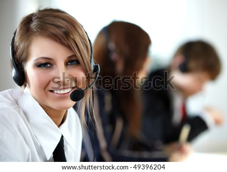 Beautiful representative smiling call center woman with headset. - stock photo