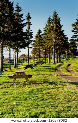 Beautiful rest area of a campground in the morning sun - stock photo