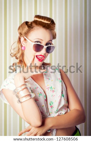 Beautiful Retro Girl With Surprised Smile Glamorising Sixties Style In Pinup Fashion On Green And White Stripe Background - stock photo