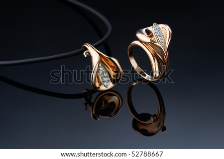 beautiful ring and pendant - stock photo