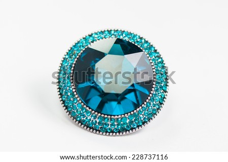 beautiful ring with blue gem (stone) isolated on white background - stock photo