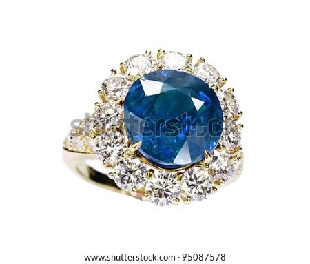 beautiful ring with blue gem (stone) isolated on white background - stock photo