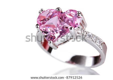 beautiful ring with pink gem isolated on white - stock photo