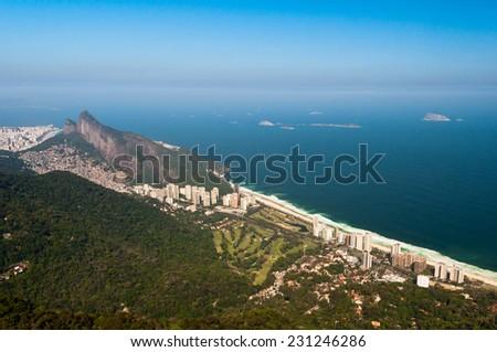 Beautiful Rio de Janeiro Landscape with Mountains, Urban Areas, Ocean in the Horizon - stock photo