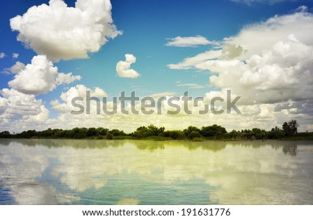 Beautiful river and cloud reflections, Oranje River South Africa - stock photo
