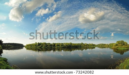 Beautiful river in the summer panorama - stock photo