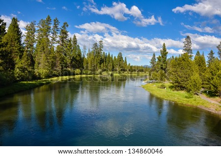 Beautiful River with Blue Sky Reflecting in Water