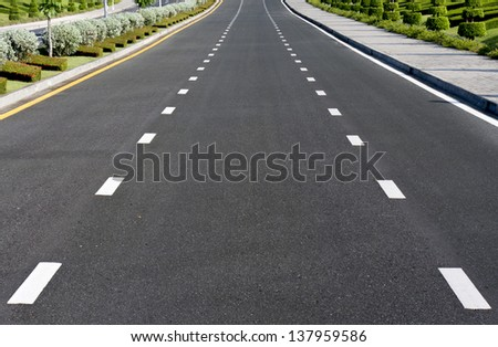 Beautiful road with garden - stock photo