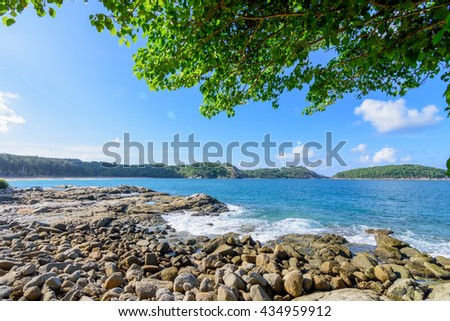 Beautiful rock beach with wave and foam in Phuket Thailand.